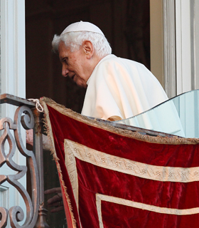 "Pope Benedict XVI turns away after making his final public appearance as pope in Castel Gandolfo, Italy, Feb. 28. The pope blessed the people gathered in the town square after he arrived via helicopter from the Vatican. ""I am a simple pilgrim who begins the last stage of his pilgrimage on this earth,"" he told the crowd. (CNS photo/Paul Haring)"