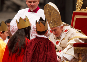 Pope Benedict XVI accepts offertory gifts from children dressed as the Three Kings during Mass on the feast of Mary, Mother of God, in St. Peter's Basilica at the Vatican Jan. 1. (CNS photo/Paul Haring)