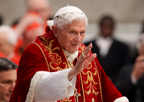 Pope Benedict XVI greets the crowd as the arrives to make remarks at the end of a Mass for the Knights of Malta in St. Peter's Basilica at the Vatican Feb. 9. The pope announced Feb. 11 that he will resign at the end of the month. (CNS photo/Paul Haring)