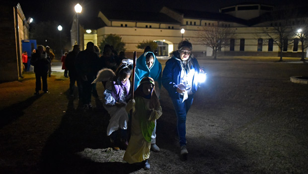 Joana Mireles, right, leads a group of children dressed as Mary, Joseph, and an angel during a Posada celebration at Immaculate Conception Church in Denton, Dec. 17. (NTC/Ben Torres)