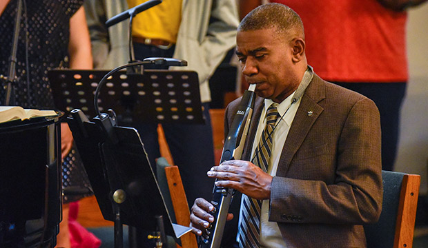 Donald Walker, Jr., plays his electronic wind instrument during a song of worship at Sunday Mass, Jan. 26, 2020 at Our Mother of Mercy Parish