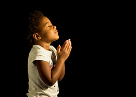 young girl in prayer