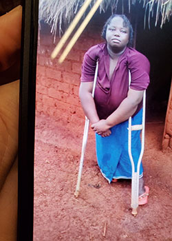 Lusambya Mkuma holds a photo of his sister