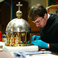 A restorer cleans part of the shrine holding St. Corona's relics