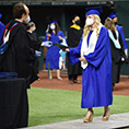 A Nolan graduate receives her diploma at Globe Life Field on July 2020