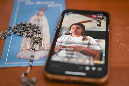 Nolan Catholic High School LIFE Team member Cecy Soto prays the Rosary live on Nolan Catholic's Instagram account on Thursday, March 26. A variety of virtual websites and livestreaming platforms are being used by youth to keep connected with fellow young Catholics. (NTC/Anna Engelland)