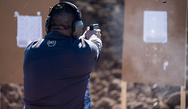 At a recent Guardian Ministry training, several parish volunteers practiced shooting from various positions under the careful supervision of Michael Short and his team of instructors.