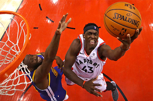 Toronto Raptors forward Pascal Siakam (43) shoots the ball against Golden State Warriors forward Draymond Green (23) in game one of the 2019 NBA Finals at Scotiabank Arena in Toronto May 30, 2019. (CNS photo/Gregory Shamus-USA TODAY Sports via Reuters)