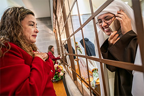 Sister Maria Sagrario receives congratulations by phone as friend Zeira Becerra looks on. (NTC/Juan Guajardo)