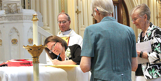 Sister Megan Grewing is seen making her first profession of vows on June 16, 2017. (Courtesy/Today's Catholic)