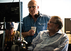 "Co-writers and directors Chuck Konzelman, standing, and Cary Solomon, right, review a scene during the filming of ""Unplanned,"" the story of Abby Johnson, a former Planned Parenthood clinic director, and her decision to join the pro-life movement."