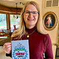 Sally Follett with book