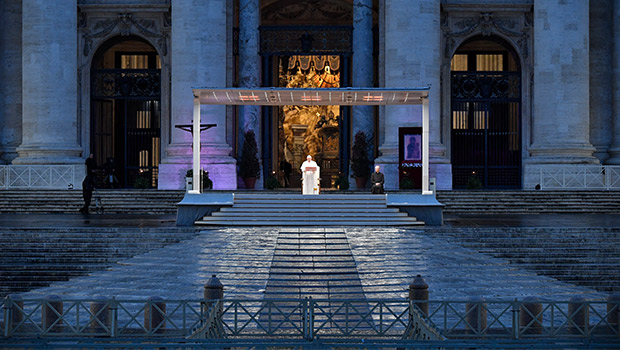 "Pope Francis leads a prayer service in an empty St. Peter's Square at the Vatican March 27, 2020. At the conclusion of the service the pope held the Eucharist as he gave an extraordinary blessing ""urbi et orbi"" (to the city and the world). (CNS photo/Vatican Media)"