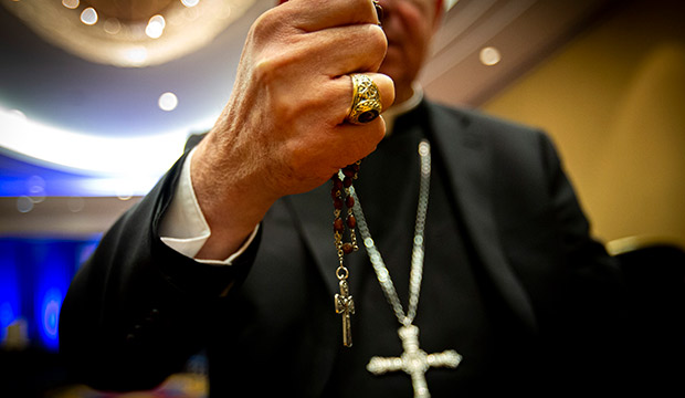 Archbishop Jose Gomez holds his rosary