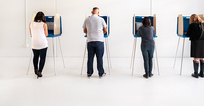 people at voting booths