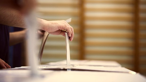 voting hand detail at ballot box