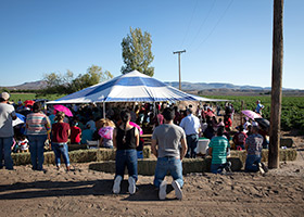 Migrant farmworkers attend an outdoor Mass Sept. 26, in Hatch, N.M., during a pastoral encounter by U.S. bishops with migrants at the border. (CNS photo/Tyler Orsburn)