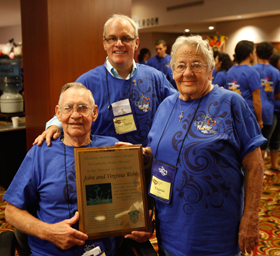 Lifetime Achievement Award  honorees, Virginia and John Webb are pictured with  Kevin Prevou, diocesan director of Youth Ministry.T he Webbs have been youth  ministers at Sacred Heart for 24 years and have been involved in youth ministry  for 30 years.