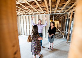 Architect Javier Lucio and WholeLife co-founder Nicole Havrilla (right) give Missy Winters a tour of the future chapel that will be on the clinic's second floor.